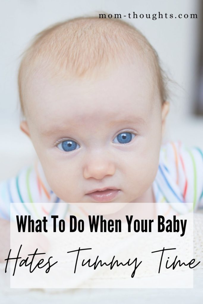 """This image is a picture of a baby doing tummy time. There's a faded white box with black text that says """"What To Do When Your Baby Hates Tummy Time"""""""