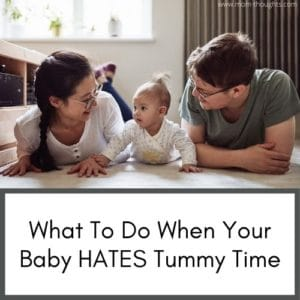 """This image shows a picture of a mom and dad on the floor with their baby doing tummy time. The baby is in between the mom and dad. Text at the bottom says """"What to do when your baby hates tummy time"""""""