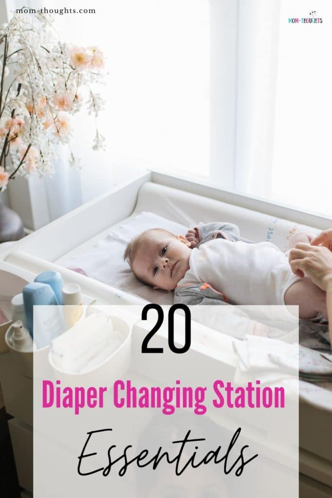 """This image shows a mom with a baby on a baby changing table. It has black text that says """"20 Diaper Changing Station Essentials"""""""