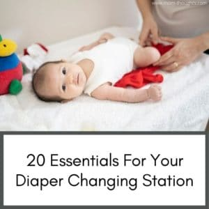 """this image has a picture of a baby on a changing table. At the bottom of the image there is text that says """"20 essentials for your diaper changing station"""""""