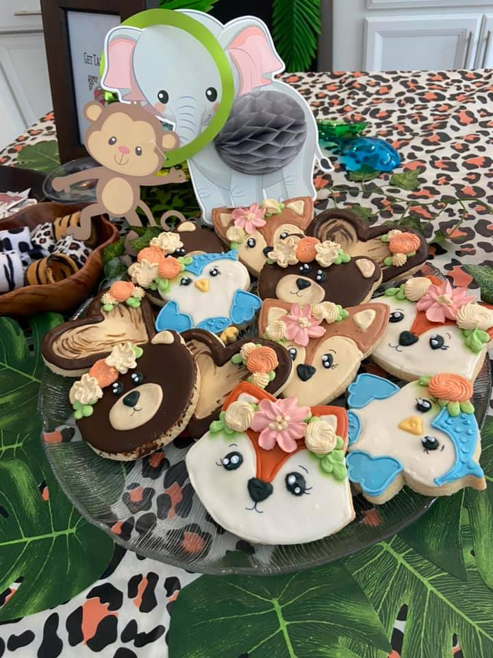 This image is of a large plate of animal cookies at a young wild and three birthday party